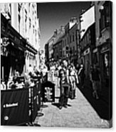 pedestrians and drinkers enjoying a sunday afternoon drink in the bunch of grapes pub high street Ga Acrylic Print
