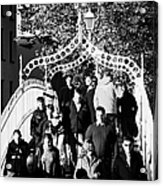 People Crossing The Hapenny Ha Penny Bridge Over The River Liffey In Dublin At A Busy Time Acrylic Print