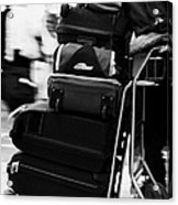 pile of luggage on trolley being pushed out of Reina Sofia Sur TFS South Airport Tenerife Canary Islands Spain Acrylic Print