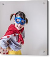 Portrait of a smiling girl dressed as a superhero Acrylic Print