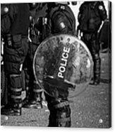 Psni Officer In Full Riot Gear With Shield On Crumlin Road At Ardoyne Shops Belfast 12th July Acrylic Print by Joe Fox
