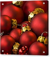 Red Christmas Baubles Acrylic Print by Anne Gilbert