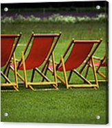 Red Deck Chairs On The Green Lawn Acrylic Print