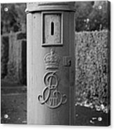 red old historic post pillar box manufactured by Handyside of Derby and London with Edward the seventh crown E Rex and VII symbols Acrylic Print