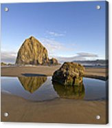 Reflection Of Haystack Rock At Cannon Beach Acrylic Print