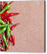 Ripe Red And Green Chillies On Cork Board Acrylic Print
