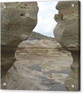 Rock Caves On The Beach Acrylic Print