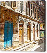 Shutters And Doors Along The Street In Bhaktapur-city Of Devotees-nepal  Acrylic Print