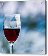 Single Glass Of Red Wine On Blue And White Background Acrylic Print