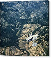 Small Plane Flying Over Mountains Acrylic Print