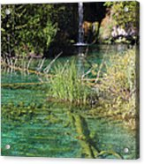 Small Waterfall And An Emerald Colored Lake Acrylic Print