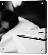 Smartphone On Bedside Table Of Early Twenties Woman In Bed In A Bedroom Acrylic Print by Joe Fox