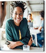Smiling Businesswoman Sitting With Colleague In Cafeteria Acrylic Print