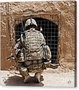 Soldier Searches A Compound Acrylic Print by Stocktrek Images