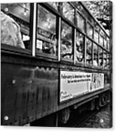St. Charles Ave Streetcar Whizzes By-black And White Acrylic Print