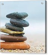 Stack Of Beach Stones On Sand Acrylic Print by Michal Bednarek