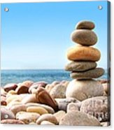 Stack Of Pebble Stones On White Acrylic Print by Sandra Cunningham