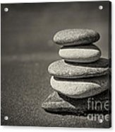 Stacked Pebbles On Beach Acrylic Print