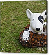 Statue Of A Dog Decorated On The Lawn Acrylic Print by Tosporn Preede