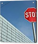 Stop Sign And Building In The Background Acrylic Print