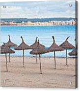 Straw Umbrellas On Empty Beach Acrylic Print