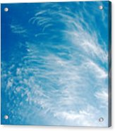 Strong Winds Forming Cirrus Clouds With A Deep Blue Sky. Acrylic Print