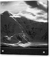 sunlight breaking through clouds on snow covered landscape of anvers island and neumayer channel Ant Acrylic Print