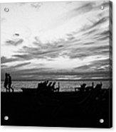 sunset over couple walking along the beach at playa de las americas Tenerife Canary Islands Spain Acrylic Print
