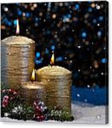 Three Gold Candles In Snow  Acrylic Print
