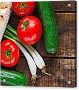 Tomatoes Cucumber Bread And Spring Onions On Old Wooden Table Acrylic Print
