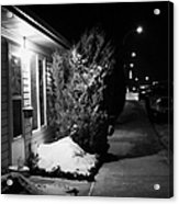 Traditional House With Porch Light Outside The Door And Snow Cleared Pavements At Night Delisle Sask Acrylic Print by Joe Fox