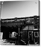train going over railway bridge elevated section of track southwark London England UK Acrylic Print
