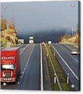 Trucks Driving Through A Misty Mountain Pass Acrylic Print