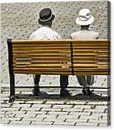 Two People Seated On A Bench Acrylic Print