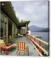 Two Women On The Deck Of A House On A Lake Acrylic Print