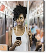 Usa, New York City, Manhattan, Portrait Of Relaxed Woman With Cell Phone In Underground Train Acrylic Print