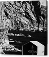 vertical small shrine with cross made out of sea shells on rocky coastline at punta de teno Tenerife Canary Islands Spain Acrylic Print