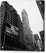 view of pennsylvania bldg nelson tower and US flags flying on 34th street from 1 penn plaza nyc Acrylic Print by Joe Fox