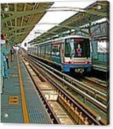 Waiting For The Sky Train In Bangkok-thailand Acrylic Print