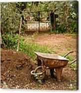 Wheel Barrow Next To Soil Heap Acrylic Print