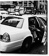 white caucasian passenger closes rear door of yellow cab on taxi rank at crosswalk on 7th Avenue Acrylic Print