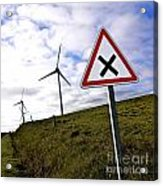 Wind Turbines On The Edge Of A Field With A Road Sign In Foreground. Acrylic Print