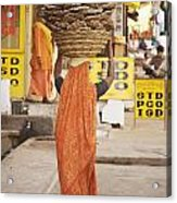 Woman Carrying Cow Dung In Basket On Acrylic Print by Paul Miles