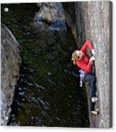 Woman Climbing Above A River Acrylic Print