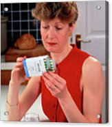 Woman Reading Dose Label On Pack Of Prozac Pills Acrylic Print
