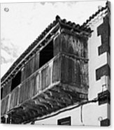 wooden balcony on ancient stucco covered traditional flat roofed house in tacoronte Tenerife Canary Islands Spain Acrylic Print