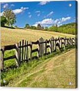 Wooden Fence In Green Landscape Acrylic Print