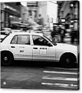 Yellow Cab Blurring Past Crosswalk And Pedestrians New York City Usa Acrylic Print by Joe Fox