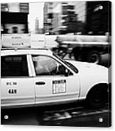 Yellow Cab With Advertising Hoarding Blurring Past Crosswalk And Pedestrians New York City Usa Acrylic Print