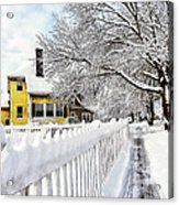 Yellow House With Snow Covered Picket Fence Acrylic Print